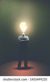 portrait of business man with light bulb on his head, surreal concept