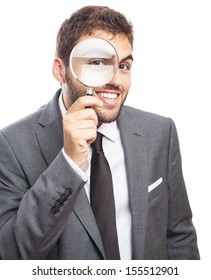 portrait of business man looking through a magnifying glass on white