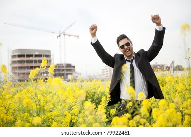 Portrait of a business man with raised arms