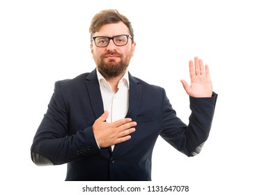 Portrait of business man showing oath gesture isolated on white background