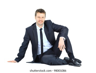 Portrait of business man sitting on the floor isolated over white background