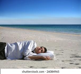 portrait of a business man sleeping on the beach