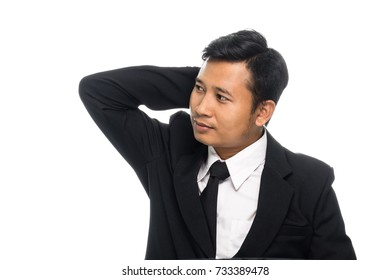 Portrait of a business man thinking with suit. Isolated on white background