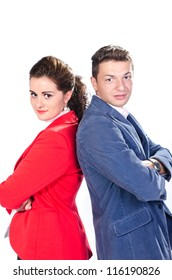 Portrait of business man and woman standing back to back against white background