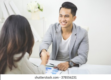 portrait of business partner make a deal in the office. shake hand