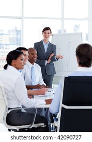 Portrait of business people discussing a new strategy at a meeting