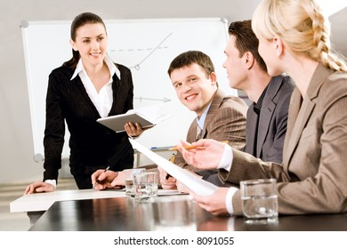 Portrait of business people discussing a new strategy at a seminar