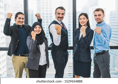 Portrait of business people group having confident in successful job in modern office background. People lifestyl and partnership colleague concept. Teamwork and cooperation diversity and multi-ethics