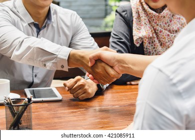 portrait of Business people shaking hands while meeting at the office