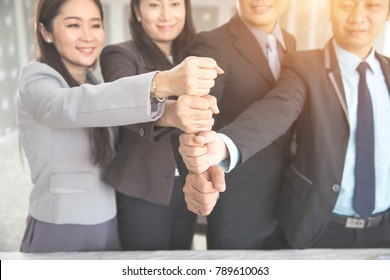portrait business people stacking hand together using as background (concept of teamwork and partnership)