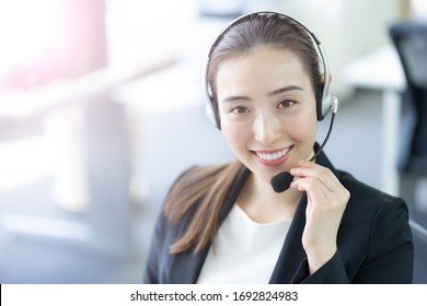 portrait of business person wearing headset working