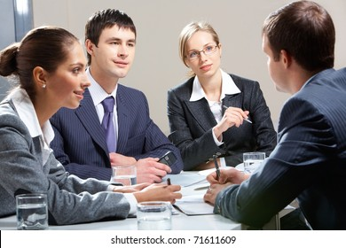 Portrait of business team interviewing man