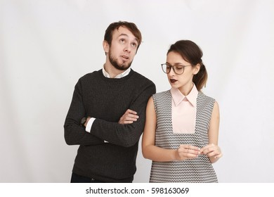 portrait of a business team at office looking at camera, executive woman at foreground and man at the background
