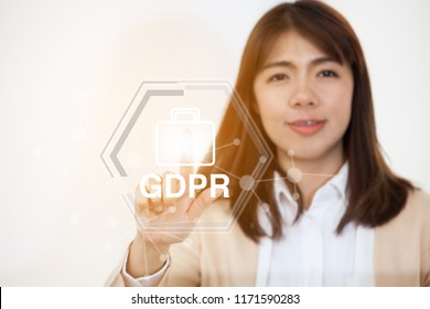 Portrait of Business Woman 20 - 30 Year Old in her office,Female Engineer hitting the Screen,the skin contains the word GPDR.Positive emotion