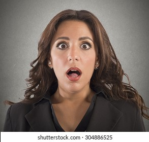 Portrait of business woman with astonished expression