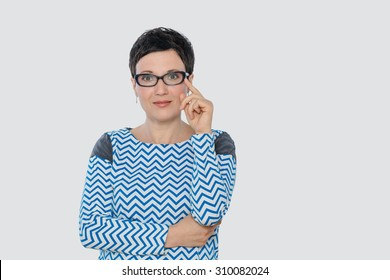 Portrait of business woman or creative professional with eyeglasses. Isolated, with copy space.