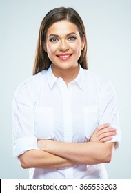 Portrait of business woman with crossed arms. Young smiling model with long hair.