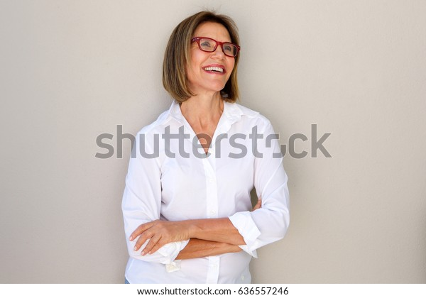 Portrait of business woman with glasses smiling
