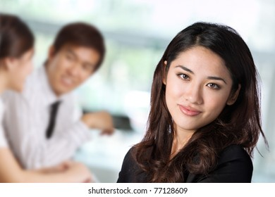 Portrait of a business woman with her colleagues in the background