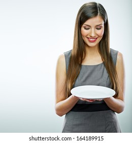 portrait of business woman hold empty white plate. Business concept portrait.