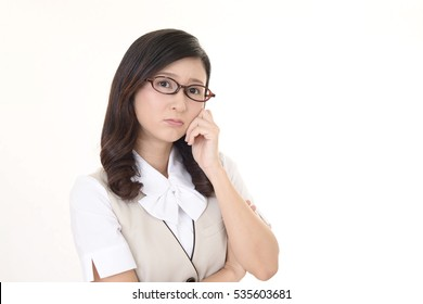 Portrait of business woman looking uneasy