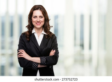 Portrait of business woman smiling in her office.