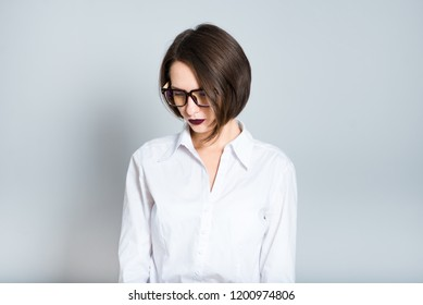 portrait of a business woman upset, short haircut, isolated over background