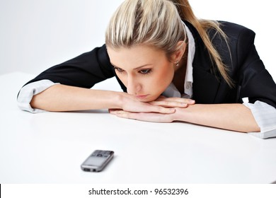 Portrait of  business woman waiting for call over white background