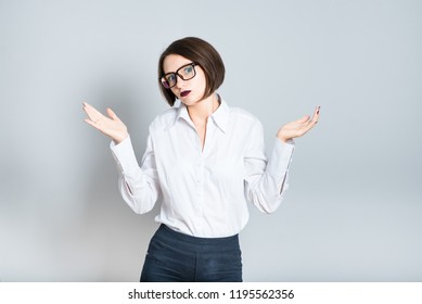Portrait of a business woman weighing options, choice, short haircut, isolated over a background.