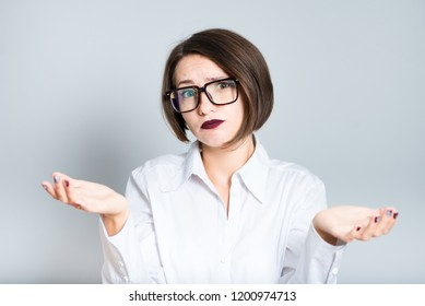 Portrait of a business woman weighing options, doubting a short haircut, isolated over a background.