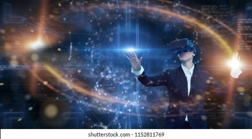 Portrait of a business woman while she is using an oculus and having a future trip with holograms. Concept: Future, technology, augmented reality