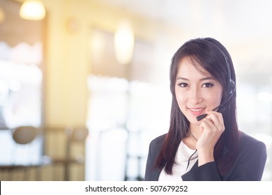 portrait of business women telemarket , call center or female customer support phone operator 20-30 years old wearing microphone headset at Customer Service has confidence in providing good service .