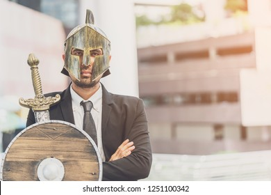 Portrait of businessman with arms crossed standing think start up business,justice and law company. A man imagination on warrior business for target, life and hope,Business Warrior in city background.