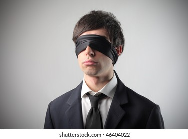 Portrait of a businessman with a bandage on his eyes