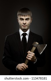 portrait the businessman  in black costume and black necktie with axe