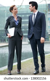 Portrait of a businessman and business woman walking together outdoors