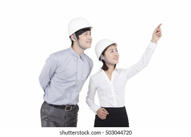 Portrait of businessman and businesswoman looking away