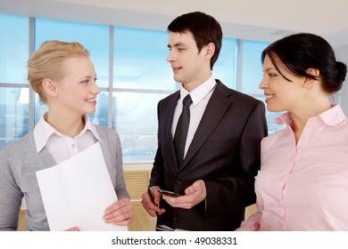 Portrait of businessman explaining work to his colleagues