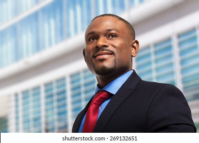 Portrait of a businessman in front of his office
