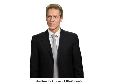 Portrait of businessman with frowning brows. Middle aged executive looking shocked and disappointed isolated on white background, copy space. Displeased mature businessman.
