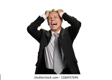 Portrait of businessman in full desperation. Depressed mature man in business suit grabbing his head with open mouth, isolated on white background.