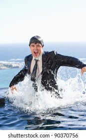 Portrait of a businessman going out of the water in a swimming pool