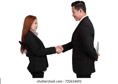 portrait businessman hold knife and businesswoman hold gun on the back isolated on white background with clipping path (comparing betrayal concept)