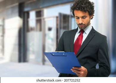 Portrait of a businessman holding a clipboard