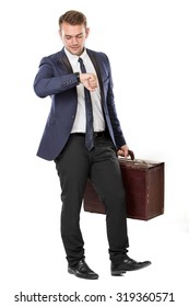 portrait of Businessman holding a suitcase while looking at his watch. ready for your design