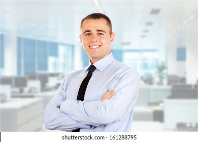 Portrait of a businessman looking on office background