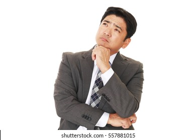 Portrait of businessman looking uneasy