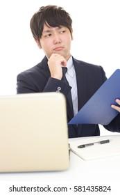 Portrait of businessman looking uneasy