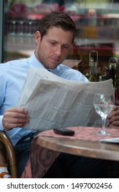 Portrait of Businessman with Newspaper