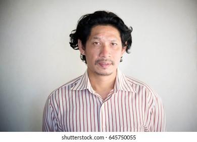 Portrait of businessman on gray background